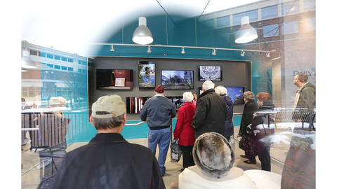 The visual lobby wall is enjoyed by the tour goers.