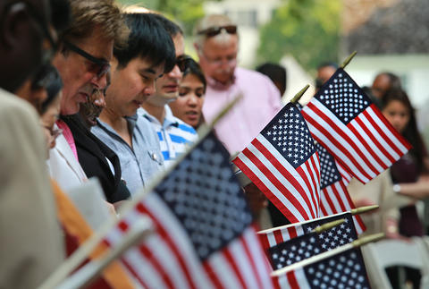 U.S. District Court for the Eastern District of Virginia held a naturalization ceremony at the Colonial Capitol, Williamsburg. The new citizens bow their heads during closing remarks.