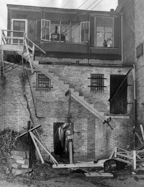 """The scene at the rear Bussie's Tavern after the fifth area bombing of a gambling house in 27 days in 1949. Though the """"handbook"""" had seemingly closed, Sheriff Stanley M. Christian said that it had been sneaking bets. Antioch residents said that Chicago gang slot operator John (Blacky) Sullivan made his headquarters there."""