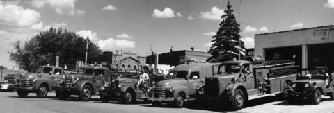 """The Antioch volunteer fire department celebrates its 50th anniversary with a parade and other festivities in 1963. The stars of the parade were these """"polished pieces of fire fighting equipment,"""" manned by 40 volunteers."""
