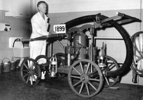 Fireman John Horan inspects an old hand pump dating back to the turn of the century in 1963. The pump drew water from wells, while a dozen men strained at pump handles. It still worked at the time.