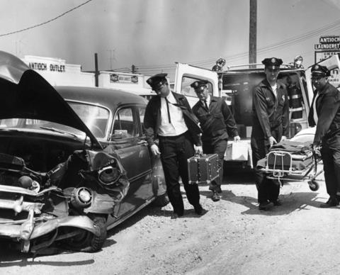 An emergency call brings the Antioch Rescue Squad to an accident scene in 1964. The squad answered 300 calls each year and celebrated its 25th anniversary in 1964.