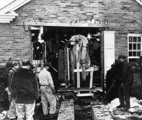 Illinois Bell Telephone Co. workers ease a 60-foot long switchboard out through a hole cut in the wall of a telephone exchange building in 1965. The 20-ton unit was placed on a truck and hauled to Richmond, Ind. for emergency replacement of equipment destroyed in a fire in the General Telephone Co. building.