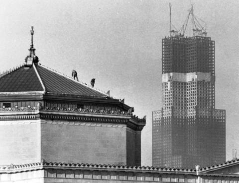 The Sears Tower, right, begins to take shape in downtown Chicago in the early 1970s.