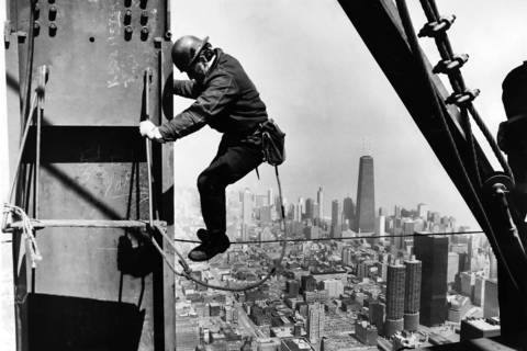 An ironworker navigates the Sears Tower in April 1973 as the then-world's tallest building nears completion.