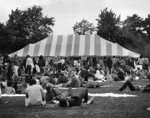 """1971: Seen through the crowds at a rock concert is the drug rescue center set up in the candy-striped tent. The college-sponsored Drug Information and Rescue Service both dispenses information on drug abuse and """"rescues"""" those who suffer from it."""