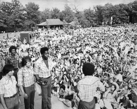 1974: The crowd takes in a performance by Free Street Theater.