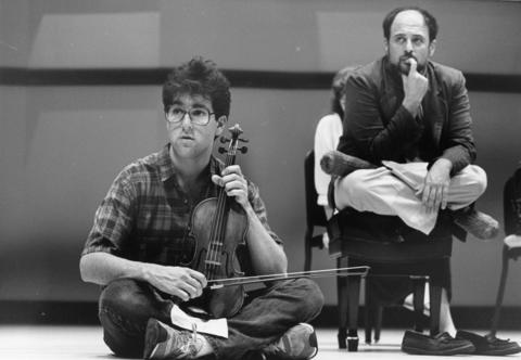 1988: Violinist Steven Miller listens to a critique of his playing at a working session of the Young Artists Institute.