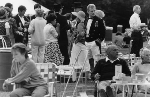 1987: Jack Anthony of Lake Bluff, in a U.S. Navy admiral's jacket, sips champagne on the lawn before a performance by the Chicago Symphony Orchestra.