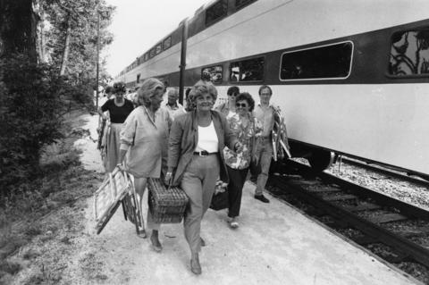 """1992: Jazz lovers disembark the """"Metra Jazz Train,"""" which runs from downtown Chicago to Ravinia's Jazz in June and plays live tunes on the way to the country's oldest summer music festival. Jazz in June kicked off Ravinia's 1992 season and featured performances by Joe Williams, Diane Schuur and Wynton Marsalis. The 10-day celebration also boasted fireworks and a world premiere of Gerry Mulligan's """"Re-Birth of the Cool,"""" a rendition of the album he recorded with Miles Davis."""