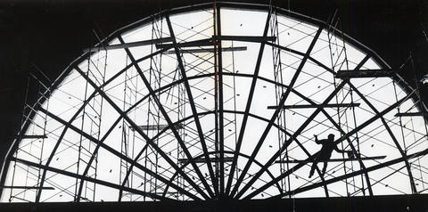 1975: Workers complete the skylight on the 16-story dome. The building features 283,200 square feet of park space and parking spots for 10,000 cars.
