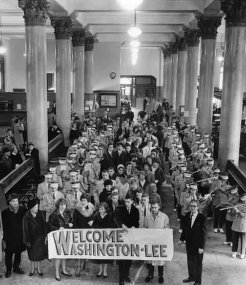 1963: Riverside-Brookfield High School band trumpets provide a welcome for Washington Lee High School students from Arlington, Va. as they arrive in Grand Central Station in Chicago. Visitors will become Riverside-Brookfield students for a week.