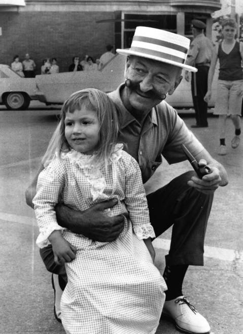 1968: Jerilynn Zamco, 3, and her grandfather, George Fricek, watch the Fourth of July parade in Brookfield.