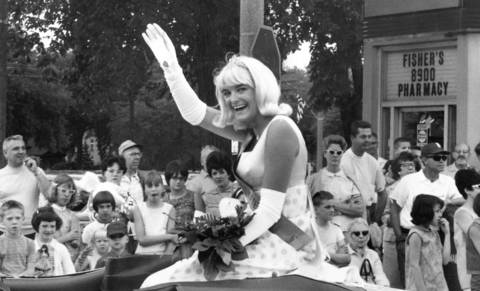 1968: Miss Brookfield Elaine Latzke waives to the crowd during the Fourth of July parade in Brookfield.
