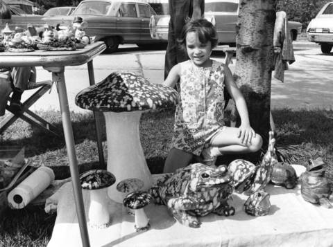 1970: Darlene Meslop, 7, checks out some ceramic artwork at the Brookfield Art Fair.