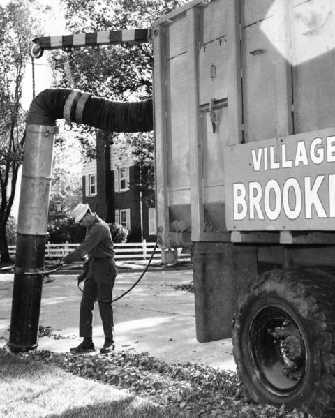 1968: James Conway, a Brookfield public works employee, uses a suction hose to gather leaves residents have swept into the street.