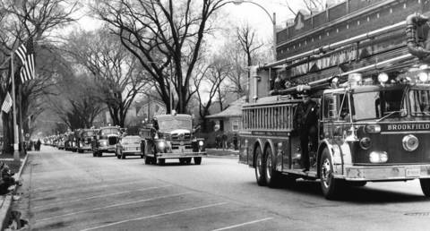 1972: Firefighters from nearby departments participate in a parade in Brookfield.