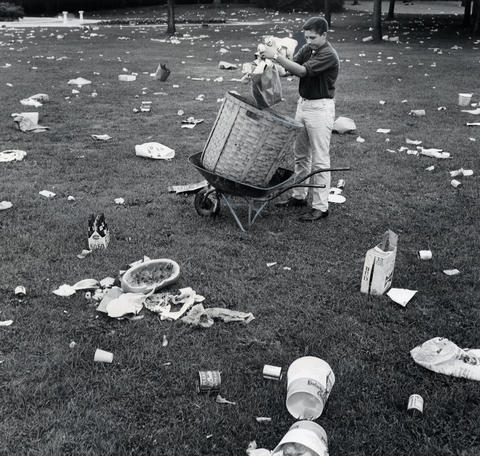 1963:Summer worker Ray Gherardina, 16, begins the unenviable task of cleaning the park of picnic litter aftera Sunday night concert by the Chad Mitchell Trio, which attracted a crowd of 12,877.