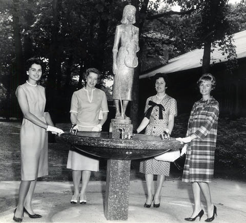 1961: Women from Sacred Heart Catholic parish take a break near a fountain while planning a benefit concert. The concert, which featured Andre Kostelanetz and the Chicago Symphony Orchestra, benefited the church's school building fund.