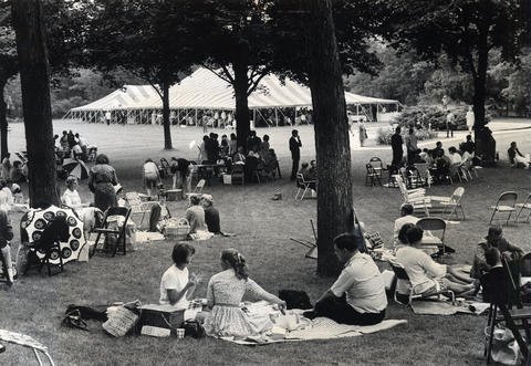 """1967: Festivalgoers dot3acres of lawn at Ravinia for the opening of the 32nd season. Some 600 members and guests attended a giant """"sup-in"""" staged by the Ravinia Women's Board before the concert."""