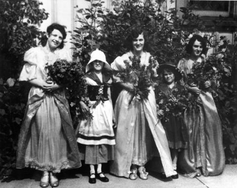 A bevy of princesses serve Alice LaFetra (right), the 1931 Lilac Queen. The tradition of selecting a queen and court began a year earlier.