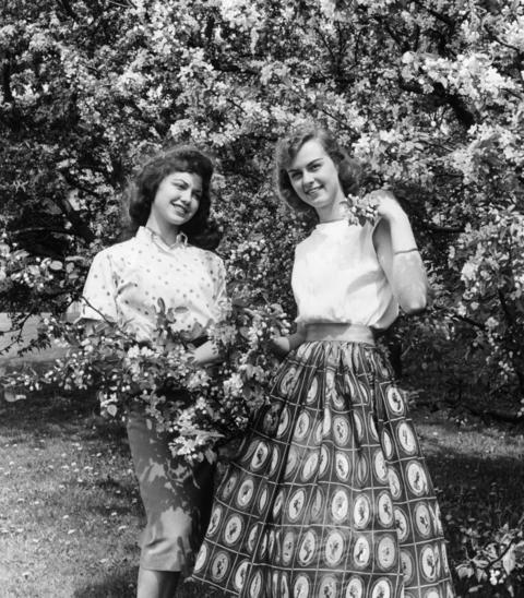 May 1960: Ann Fromelius, left, and Jill Gabbhardt, both of Lisle, pose among some of the blossoms at Morton Arboretum.