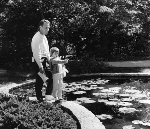 September 1966: Edward Russell and daughter Pamela, 5, pause to admire the lily pond at Morton Arboretum.