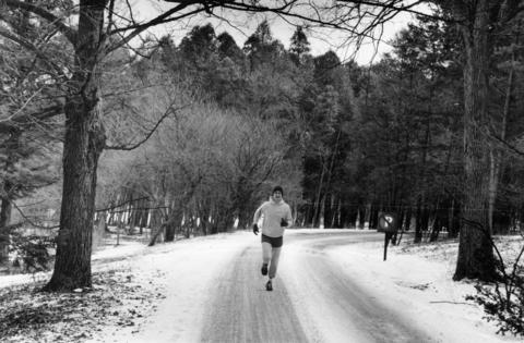 March 1984: Braving the brisk weather, a jogger makes his way along one of the paved roads leading through Morton Arboretum. Each year, nearly half a million visitors explore the arboretum's 1,500 acres of cultivated and natural vegetation.