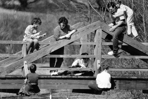 March 1987: A group of young people soaks up the sun amid the natural splendor of Morton Arboretum.