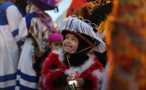 Two-year-old Alair Depatz smiles while waiting to march in the Halloween Gathering Parade on South Columbus DriveonOct. 24, 2015, in Chicago.