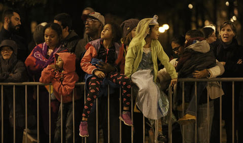 People watch the Halloween Gathering Parade on South Columbus Drive onOct. 24, 2015, in Chicago.