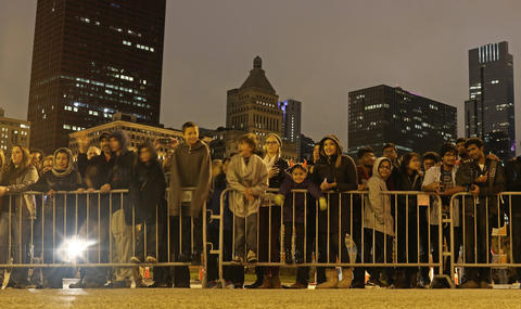 People watch the Halloween Gathering Parade on South Columbus DriveonOct. 24, 2015, in Chicago.
