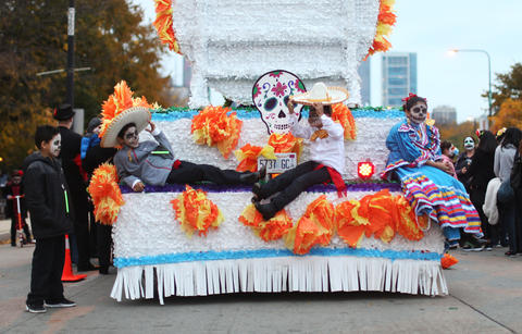 A group of children rest before marching in the Halloween Gathering Parade on South Columbus Drive onOct. 24, 2015, in Chicago.