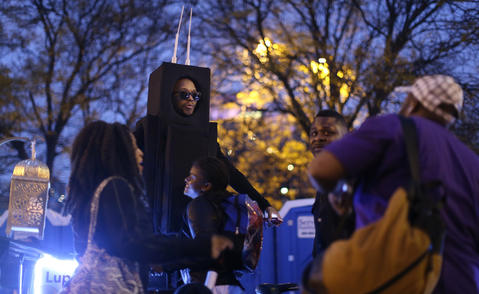 Performance artist Lupe Fiasco wears a Willis Tower costume for the Halloween Gathering Parade on South Columbus Drive onOct. 24, 2015, in Chicago.