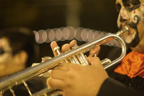 Trumpeter Mike Espinosa performs during the Halloween GatheringParade on South Columbus Drive onOct. 24, 2015, in Chicago.