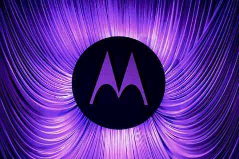 A Motorola logo is seen before a press conference by Motorola during the 2014 Mobile World Congress in Barcelona.