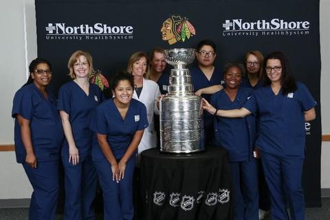 College of Lake County nursing students and faculty doing clinicals at Highland Park Hospital pose with the ‪‎Chicago Blackhawks‬' Stanley Cup on Oct. 13.