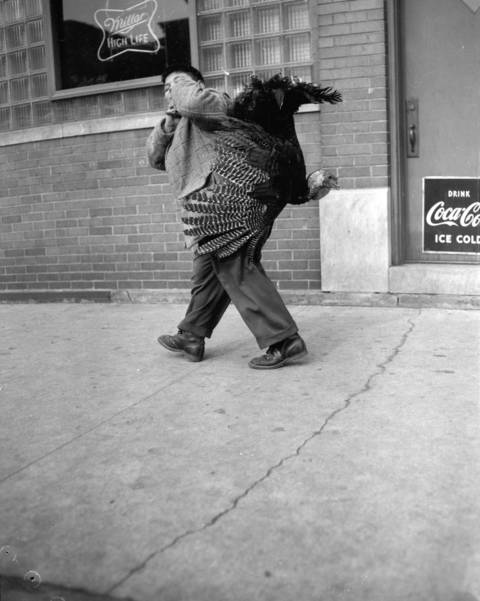 Richard Cozzi, 11, rushes to his home on South Morgan Street in Chicago with a turkey for Thanksgiving dinner in November 1955.