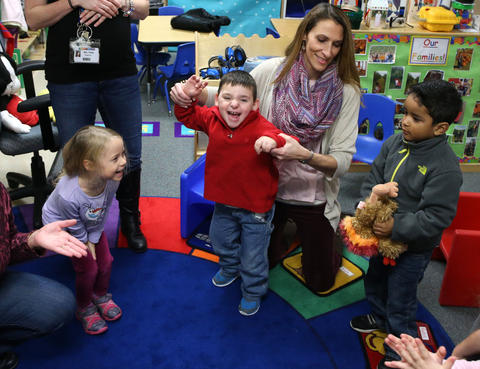 Matthew Erickson, 3, center, plays with friends during preschool Nov. 18, 2015, at Chesak Elementary School in Lake in the Hills. By the time he turned 2, Matthew had endured six brain surgeries, five rounds of chemotherapy and thousands of blood draws.