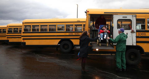 Matthew Erickson gets off the bus to attend preschool Nov. 18, 2015, at Chesak Elementary School in Lake in the Hills.