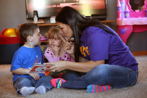 Matthew Erickson reads books with his sister, Sophia, 5, and his mom, Sue, at their home in Huntley on Nov. 15, 2015.