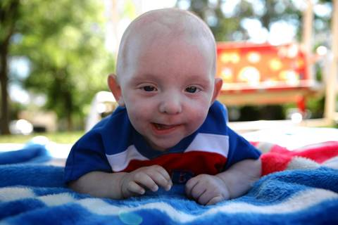 Matthew Erickson, 5 months, lies on a blanket in his front yard on a beautiful spring day May 13, 2012.