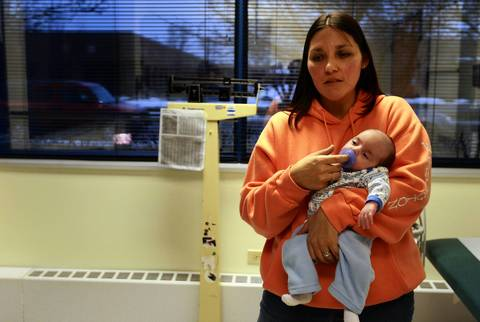 Sue Erickson holds her son Matthew in the doctor's office Jan. 23, 2012.