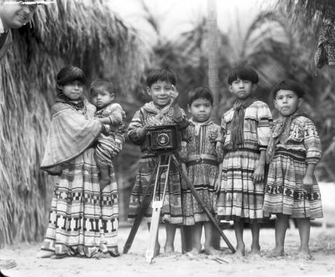 A group of Seminole Indian children pose in the Seminole Village in 1933 at the Century of Progres Exposition. The Seminole tribe, which entertained the crowds at the fair by wrestling alligators, was from the Florida Everglades.