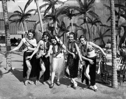 Hula girls Lehua Macklea, Leilani Hua, Nettie Paauhau, Blanche Kailua and Mildred Lionane pose in the Hawaiian Village on June 5, 1934. The Hawaiian Village was new to the fair in 1934 and featured the Schlitz Palm Garden restaurant, with native music and dancing by Hawaiian entertainers.