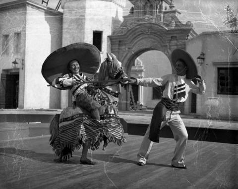 Winnie Hannon and Beto Parlato re-enact a bullfight in the Mexican Village on June 8, 1934.