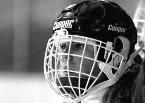 Jan., 1990: An unidentified member of Lake Forest Academy's girls' hockey team watches practice. The school was the first and only in the state to have a female hockey team, so they played games against the team from Lake Forest College.