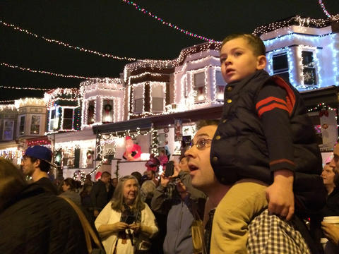 Spectators enjoy the light show at the annual Christmas lighting on 34th Street in Hampden.