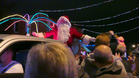 Baltimore, MD -- Santa Clas arrives by pickup during the annual lighting of Christmas lights in Hampden for the holiday season.Karl Merton Ferron/Baltimore Sun (frame#P3460553-010813.jpeg; )