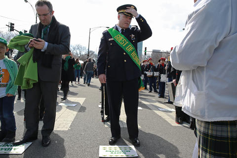 Chicago police Superintendent Garry McCarthy adjusts his cap before marching in the St. Patrick's Day Parade on South Columbus Drive on March 14, 2015, in Chicago.